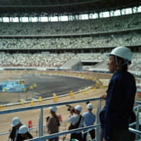 Construction demand, including for the new National Stadium, forms a large part of short-term Olympic economic benefits.   RYUSEI TAKAHASHI