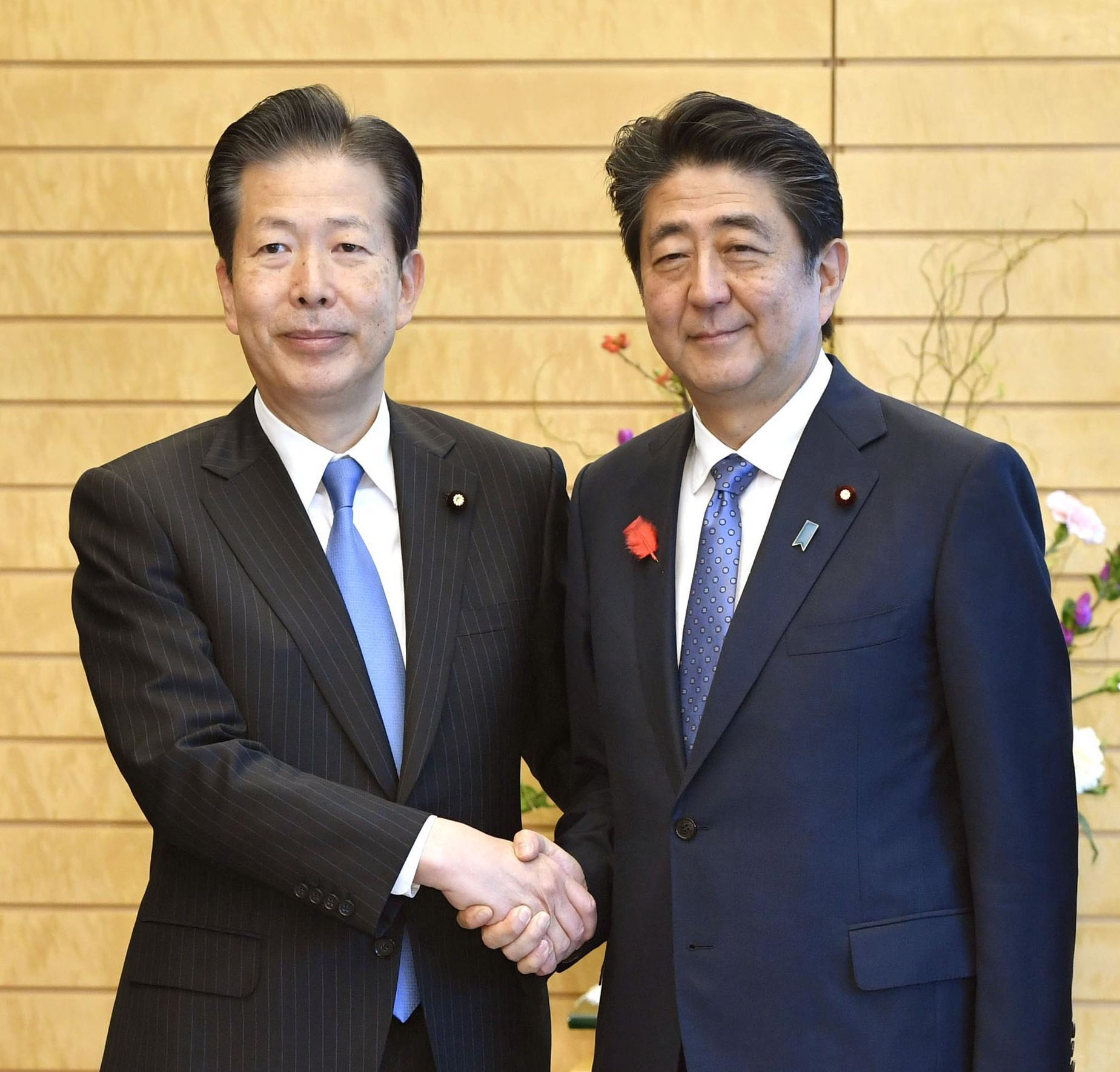 Komeito President Natsuo Yamaguchi and Prime Minister Shinzo Abe pose in this file photo. Two decades after forming a coalition, the ruling Liberal Democratic Party and junior partner Komeito say their partnership has brought stability to politics.   KYODO