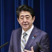 Prime Minister Shinzo Abe speaks during a news conference Monday after the close of the extraordinary Diet session that began Sept. 26. | KYODO