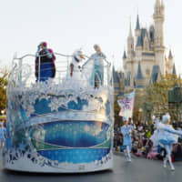 A parade featuring the animated movie 'Frozen' is held at Tokyo Disneyland in Urayasu, Chiba Prefecture, in 2015. | KYODO