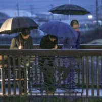 Emperor, empress console victims in typhoon-hit areas of Japan's northeast