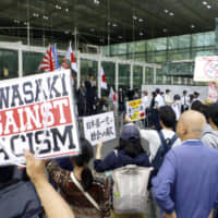 Counterprotesters denounce a rally by right-wing nationalists in Kawasaki in May. The city has passed an ordinance against hate speech that can lead to criminal penalties for violators.