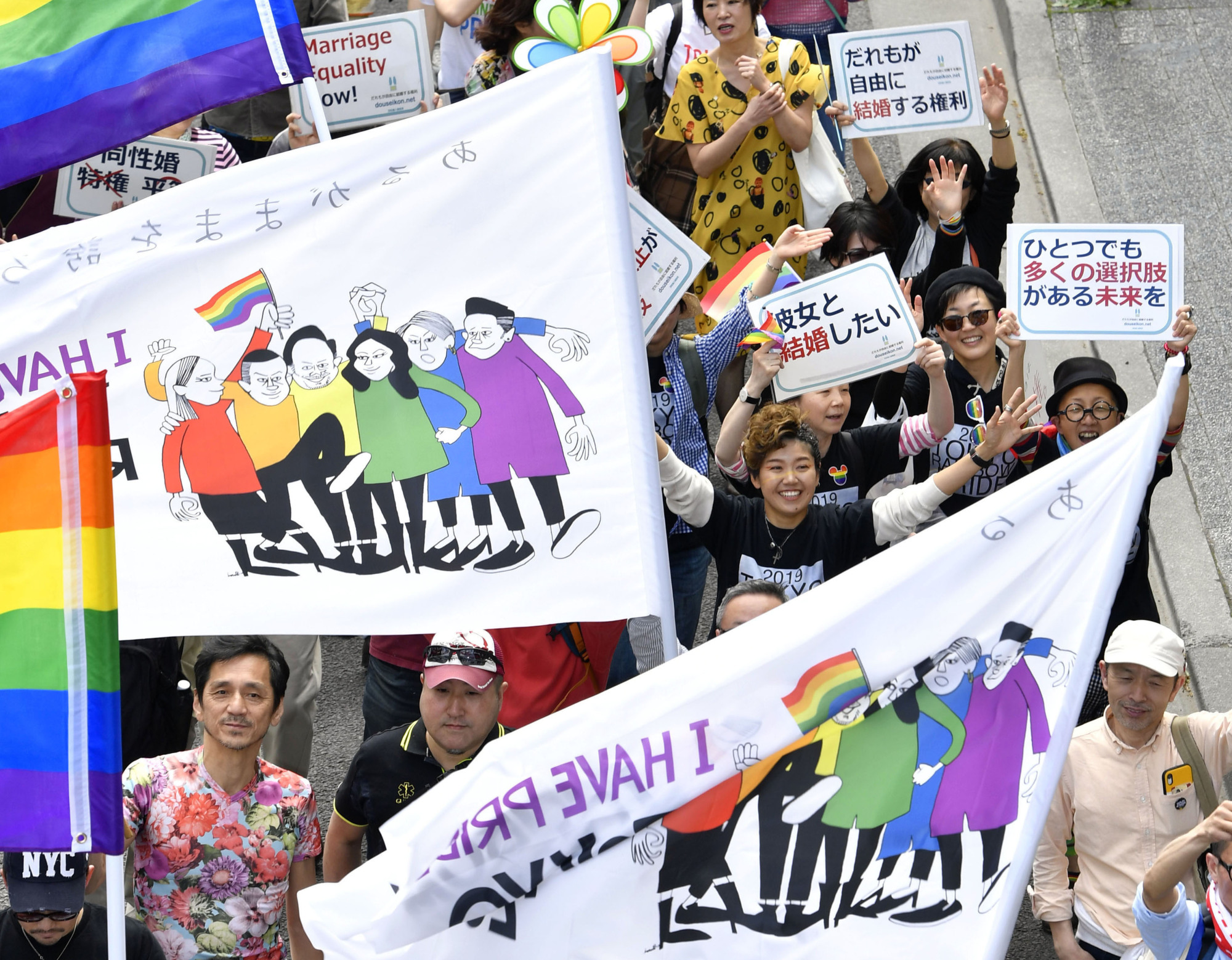 People march through the Shibuya district of Tokyo during the Tokyo Rainbow Pride 2019 parade in April. | KYODO