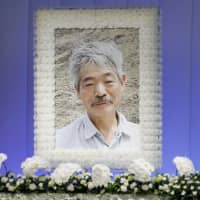 A picture taken in Afghanistan of Japanese physician Tetsu Nakamura is displayed on the altar at his funeral in Fukuoka on Wednesday. | KYODO