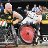Daisuke Ikezaki clashes with an Australian player during a men's wheelchair rugby game in Tokyo in October. Wheelchair rugby is one of the most popular para-sports. | KYODO