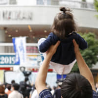 New dads in Japan's civil service to be encouraged to take month of paternity leave
