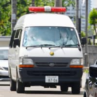 A police car transports Vayron Jonathan Nakada Ludena to a police station in Kumagaya, Saitama Prefecture, in May 2016. | KYODO