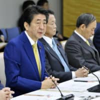 Prime Minister Shinzo Abe speaks at a meeting on reconstruction measures at the Prime Minister's Office on Thursday. | KYODO