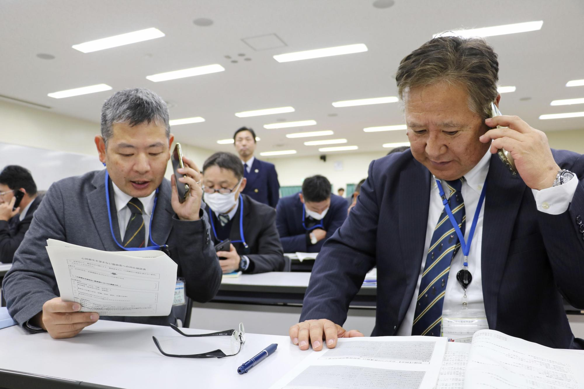 Ambulance workers attend a seminar organized by the Tokyo Fire Department in November to prepare for new rules created to allow resuscitative efforts to be stopped on request. | KYODO