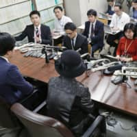 The mother of a man killed in a 2017 road rage incident holds a news conference Friday in Tokyo after the Tokyo High Court sent the case back to a lower court due to an illegal procedural issue. | KYODO