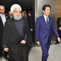 Iranian President Hassan Rouhani and Prime Minister Shinzo Abe prepare to hold talks at Abe's office in Tokyo last week. | KYODO