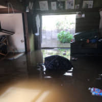 David and Yoko Bowen's home is flooded on Oct. 26, with waters rising 60 centimeters high. | COURTESY OF YOKO BOWEN