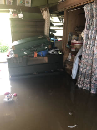 Floodwaters inundate David and Yoko Bowen's house in Sakura, Chiba Prefecture, on Oct. 26. Furniture and clothes on the first floor were submerged in water. | COURTESY OF YOKO BOWEN