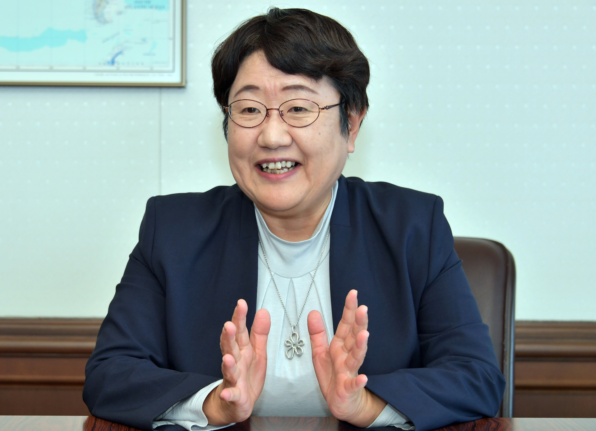 Shoko Sasaki, commissioner of the Immigration Services Agency, is interviewed at the Justice Ministry on Dec. 20. | YOSHIAKI MIURA