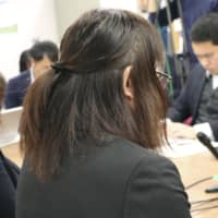 A transgender woman who filed a claim Tuesday to change her sex in Japan's official family register speaks at a news conference the same day in Amagasaki, Hyogo Prefecture. | KYODO