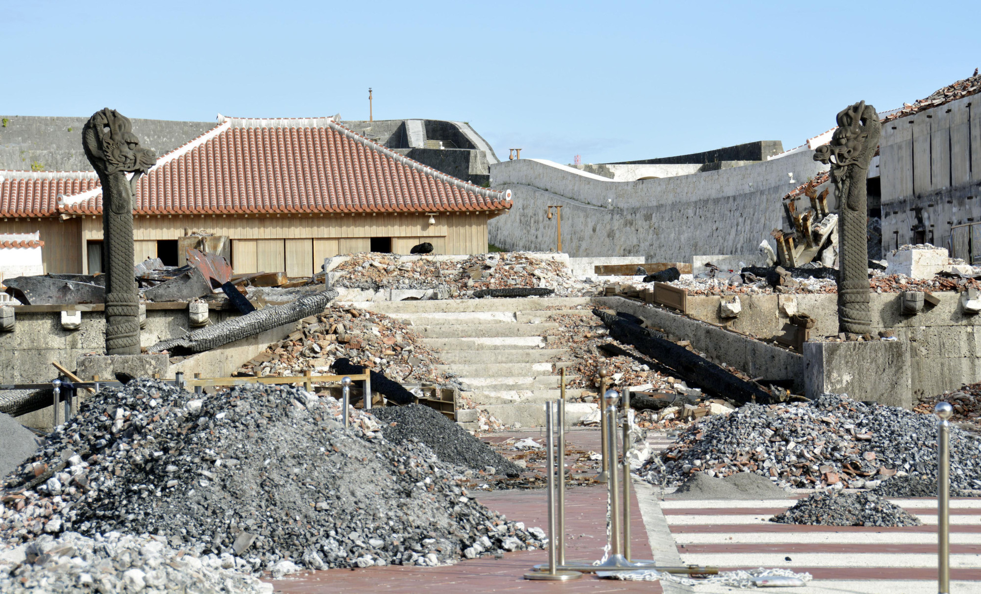 The burned-out remains of buildings at Shuri Castle, the main symbol of Okinawa Prefecture, are shown in Naha after a fire destroyed part of the UNESCO World Heritage site in October. | KYODO