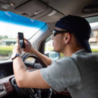 Tougher penalties for smartphone use while driving take effect in Japan