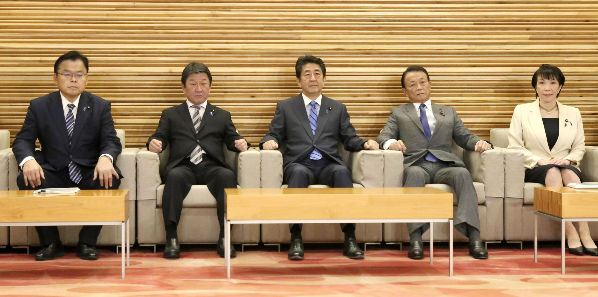 Prime Minister Shinzo Abe and other Cabinet ministers pose for a photo at the Prime Minister's Office on Tuesday before a Cabinet meeting. | KYODO