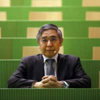 Haruhiko Kuroda, governor of the Bank of Japan, poses before delivering a speech at the University of Zurich in Switzerland. | PHOTOGRAPHER: STEFAN WERMUTH/BLO