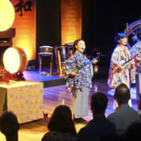 Musicians play three-stringed instruments from Okinawa Prefecture known as sanshin during a Japanese traditional arts show at the Sydney Opera House on Monday. | KYODO