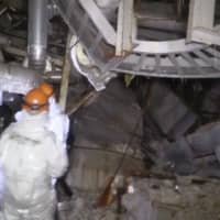 In this video released Thursday by the Nuclear Regulation Authority, inspectors can be seen checking the inside of the No. 3 reactor building at Fukushima's No. 1 plant earlier this month. | NRA / VIA KYODO