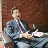 Masaru Tomita, director general of the Institute for Advanced Biosciences, Keio University, is interviewed at his home in Tokyo on Nov. 13.   TOMOHIRO OSAKI