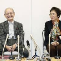 Scientist Akira Yoshino, winner of the Nobel Prize in chemistry, attends a news conference with his wife, Kumiko, at the Narita Airport on Sunday. | KYODO