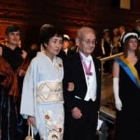 Japanese chemist and co-laureate of the 2019 Nobel Prize in chemistry Akira Yoshino and his wife, Kumiko, arrive for a royal banquet to honor the laureates of the Nobel Prize 2019 following the Award ceremony on Tuesday in Stockholm. | AFP-JIJI