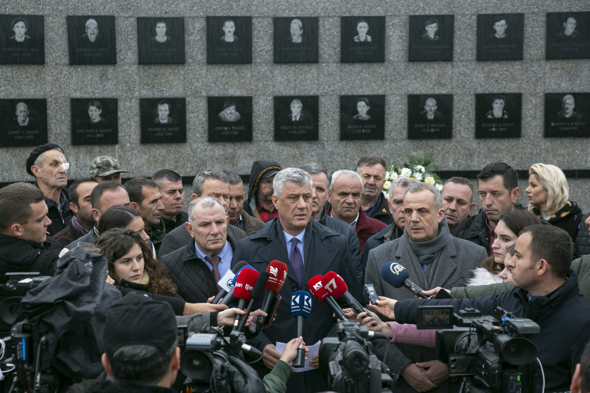 Kosovo President Hashim Thaci visits the Recak memorial on Dec. 10, where he called on Serbia to apologize for the genocide on his country as the first step toward a peaceful relationship. | AP