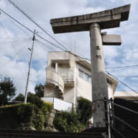 Somber reminders: A one-legged torii gate stands testament to Nagasaki's destruction by the atomic bomb dropped in 1945. | JESSE CHASE-LUBITZ