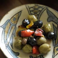 Olives and fishes: Olives from nearby Italy are served on a fish-pattern dish made by Jiro Kinjo (1912-2004), who was a National Living Treasure from Okinawa. | HIROSHI ABE