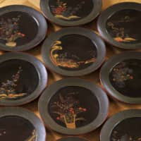 Preserved heritage: This set of 10 lacquer plates was made in the 18th century in present-day Okinawa. Such antique pieces of Ryukyu lacquerware are extremely rare even in Japan because so much was lost during the devastation of the Battle of Okinawa in 1945. | HIROSHI ABE