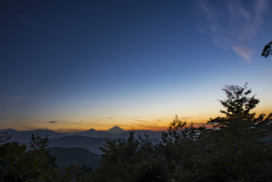 Hot spot: Mount Takao is one of the most popular places to watch the sunrise near Tokyo, with crowds gathering in the early hours of the morning see first light over the capital and Mount Fuji. | GETTY IMAGES