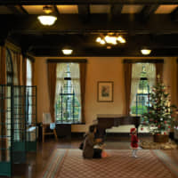 Deck the halls: A mother and daughter celebrate Christmas early inside the grand Berwick Hall. | RUSSELL THOMAS