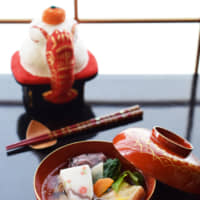 Feast for the eyes: Tokiko Iino plates this osechi ryōri (New Year's feast food) in a red bowl in front of a festive kagamimochi New Year's decoration. | TOKIKO IINO