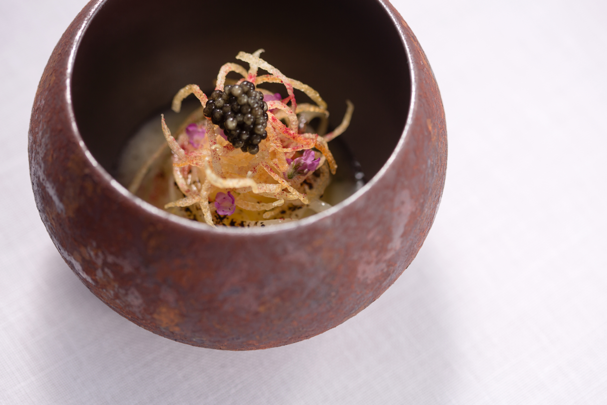 Elevating the humble potato: Chef Kotaro Noda's potato 'spaghetti' pairs well with aged wines that have roundness and depth to balance the richness of the dish. | COURTESY OF FARO