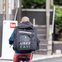 Independent operators: Uber Eats delivery personnel are their own bosses in that they possess their own vehicles and only work when they want to. | GETTY IMAGES