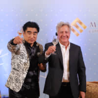 Handa raises a toast with actor Dustin Hoffman at the hotel on Dec. 8. | ISPS