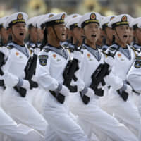Chinese sailors commemorate the 70th anniversary of the People's Republic of China in Beijing on Oct. 1. China continues to build up its military to challenge and supplant the United States as the pre-eminent power in the Indo-Pacific region. | AP