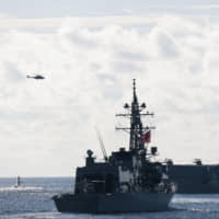 The Maritime Self-Defense Force Izumo helicopter carrier and the Murasame destroyer participate in joint multi-nation exercises in the Indo-Pacific region on May 21. | COMMANDER, TASK FORCE 70 / CARRIER STRIKE GROUP 5