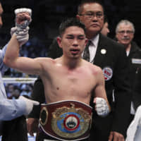 Kazuto Ioka is declared the winner by the referee after beating Puerto Rican challenger Jeyvier Cintron in their WBO super flyweight world boxing title match on Tuesday in Tokyo. Ioka won via unanimous decision. | AP