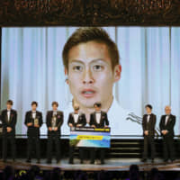Marinos midfielder Teruhito Nakagawa accepts the J. League's Most Valuable Player award via teleconference from Busan, South Korea, during the league's awards ceremony on Sunday in Tokyo. | KYODO