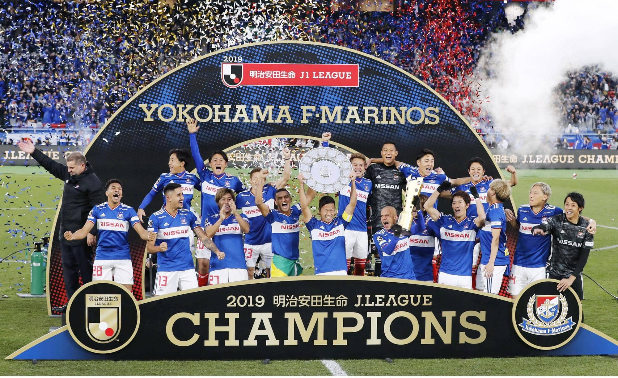 Yokohama F. Marinos players take part in a victory celebration after capturing the J. League first-division title on Saturday by beating FC Tokyo 3-0. | KYODO