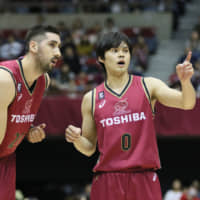 Kawasaki forward Mathias Calfani (left), who hails from Uruguay, has made a positive impact for the title-chasing Brave Thunders this season at both ends of the floor. | B. LEAGUE