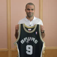 Retired Spurs guard Tony Parker, seen in Tokyo on Thursday, had his No. 9 jersey retired last month. | YOSHIAKI MIURA