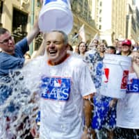 Major League Baseball Commissioner-elect Rob Manfred participates in the ALS Ice-Bucket Challenge outside the organization's headquarters in New York in 2014.   AP