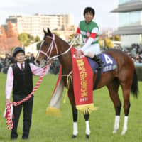 Yuichi Kitamura sits atop Resistencia after winning the Hanshin Juvenile Fillies on Sunday in Takarazuka, Hyogo Prefecture. | KYODO