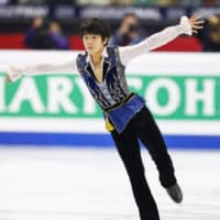 Shun Sato, a 15-year-old from Sendai, captured the Junior Grand Prix title on Saturday with a stunning free skate. | KYODO
