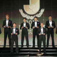 Eight players selected to the J. League's Best XI for the 2019 season pose onstage at the league's annual awards ceremony in Tokyo on Sunday. | KYODO