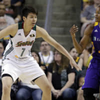 Seattle's Ramu Tokashiki defends Los Angeles' Alana Beard in the first half of Saturday's game in Seattle. AP | AP